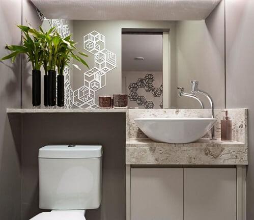 Lavabo com bancada de mármore travertino Projeto de Mis Arquitetura e Interiores