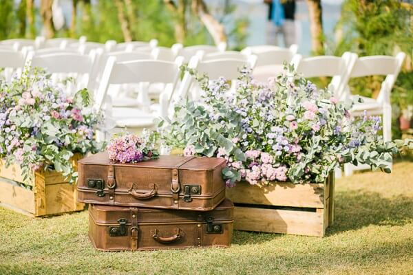 Leather bags and wooden crates are part of simple wedding decoration