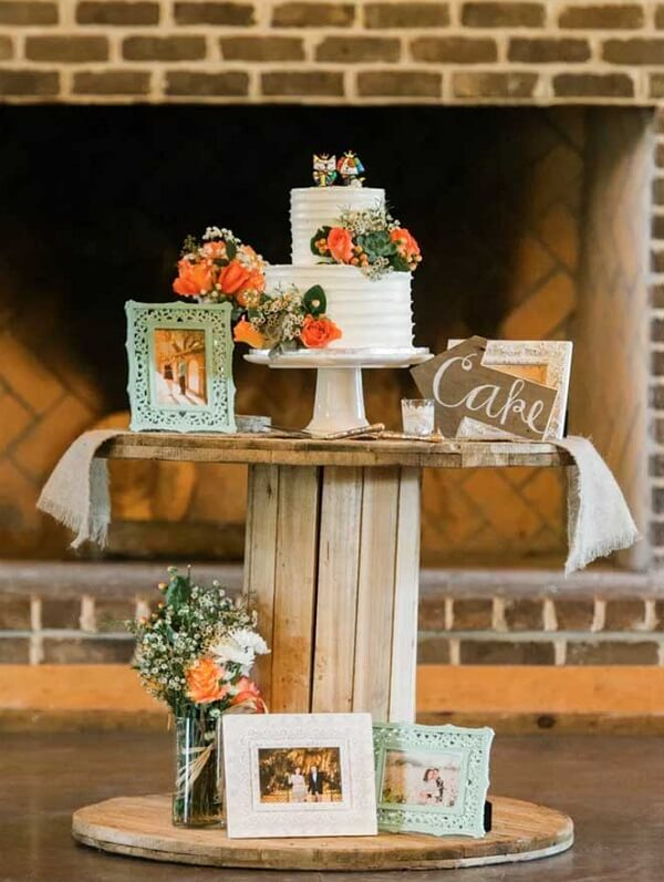 In simple wedding decoration use the wooden spool as a table
