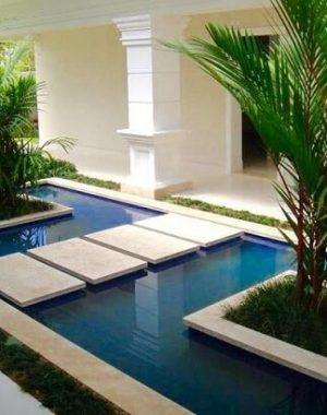 Piso para piscina de granito Projeto de Daniel Nunes Paisagismo