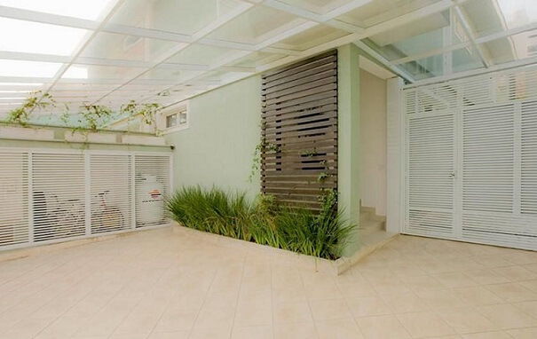 Quintal com telhado de vidro Projeto de Idalia Daudt