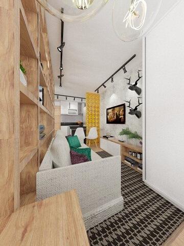 Sala de estar com meia parede de cobogó separando da cozinha Projeto de Jessica Campos