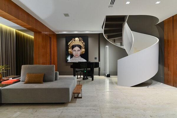 Sala de estar com piso de mármore travertino Projeto de Batistelli Arquitetura
