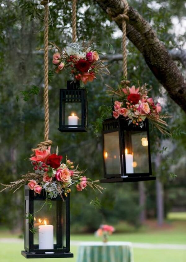 If the wedding is outdoors hang lamps on trees