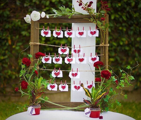 Love clothesline complements simple wedding decoration