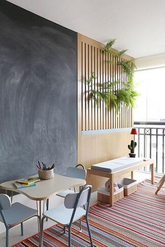 Varanda com parede de tinta lousa Projeto de Quattrino Arquitetura