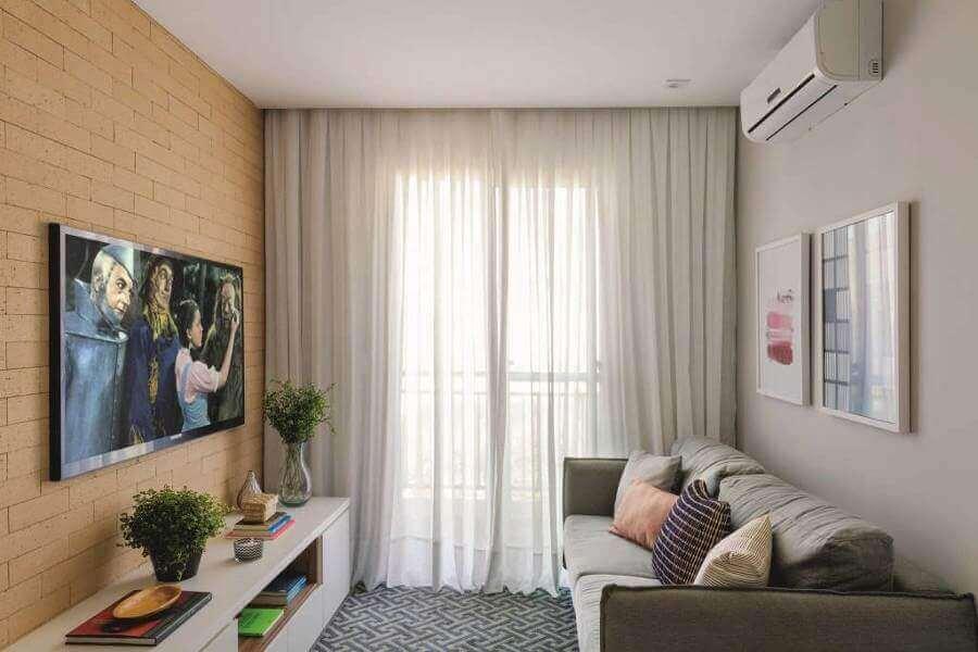 apartamento pequeno com parede de tijolinho