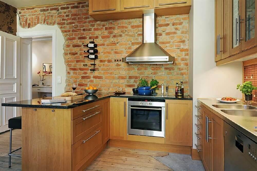 cozinha com parede de tijolinho a vista