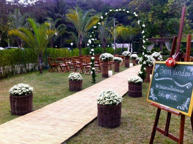 simple outdoor wedding decoration with baskets of flowers