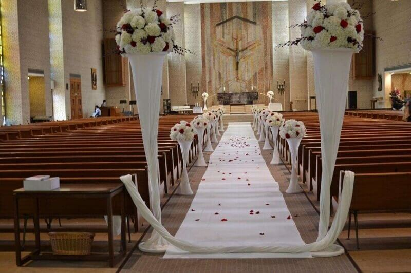 church decoration for marriage with white and red flowers
