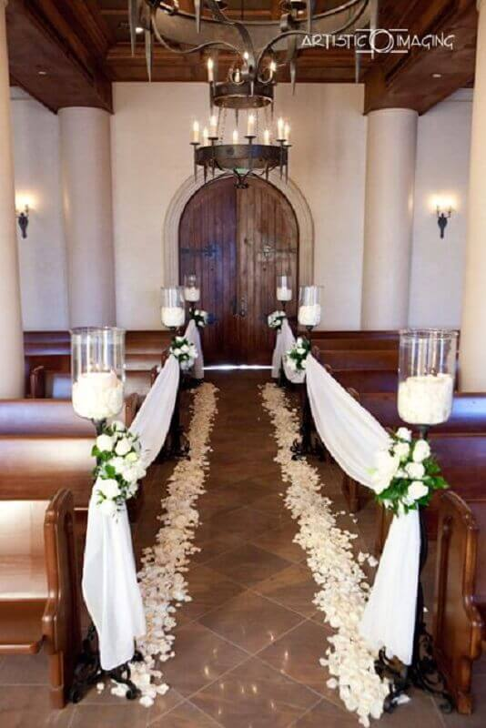 church decoration for wedding with candles and flowers