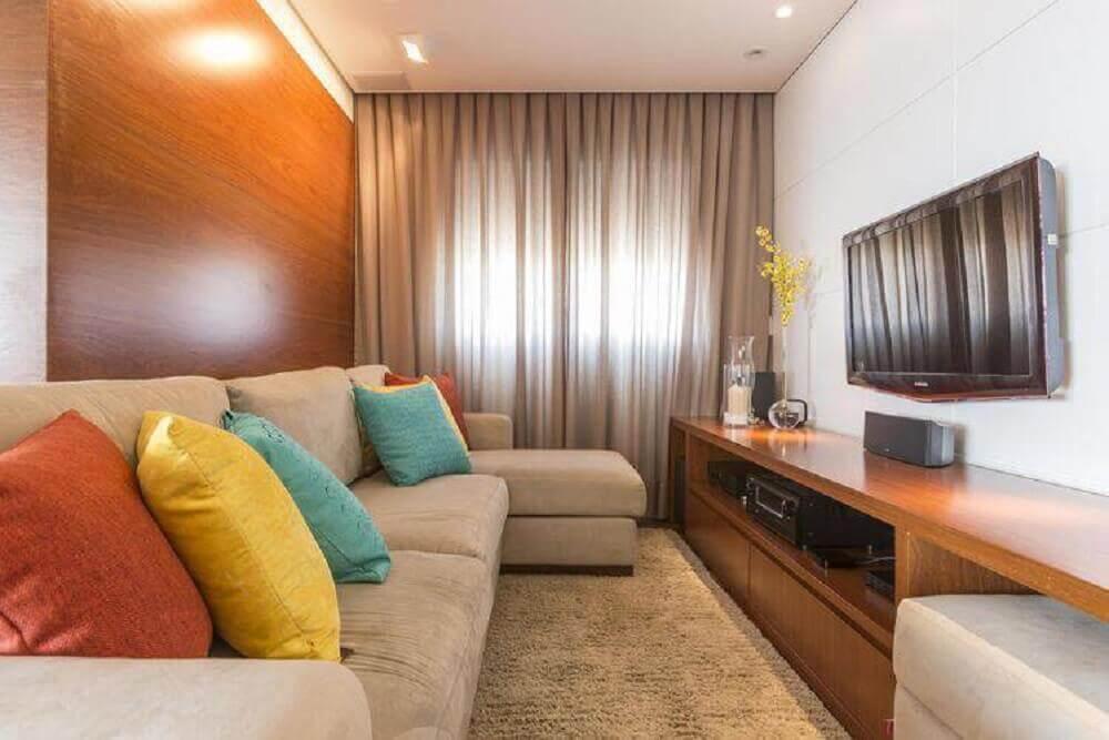 decoração de sala simples com almofadas coloridas