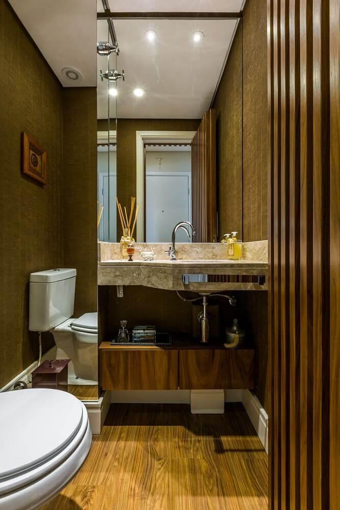 decoração lavabo com parede revestida com espelho