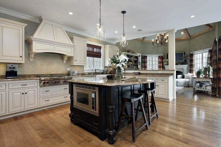 sofisticada cozinha com ilha preta
