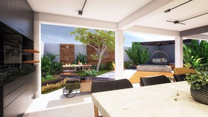 Área de lazer com churrasqueira e decoração moderna Projeto de Uba Arquitetura