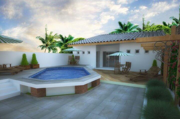 Área de lazer com piscina e espreguiçadeiras Projeto de Alfredo Gomes