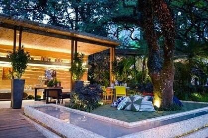 Casa com varanda e jardim Prjeto de Cactus Arquitetura