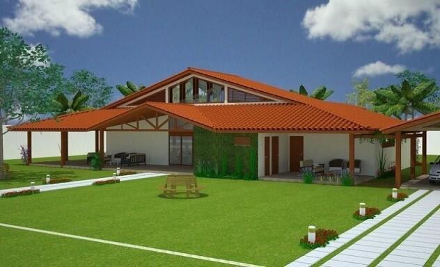 Casa com varanda e jardim frontal amplo Projeto de Luiz Moreira