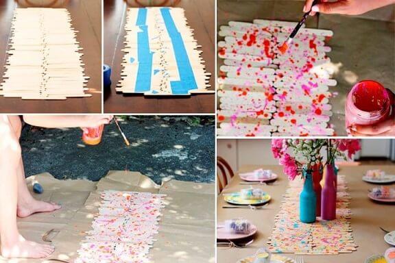 Decoração de aniversário simples com enfeite de mesa feito de palitos de picolé
