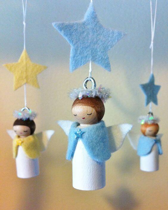 Mobile de anjinhos feito de artesanato com rolo de papel higiênico. Fonte: Pinterest