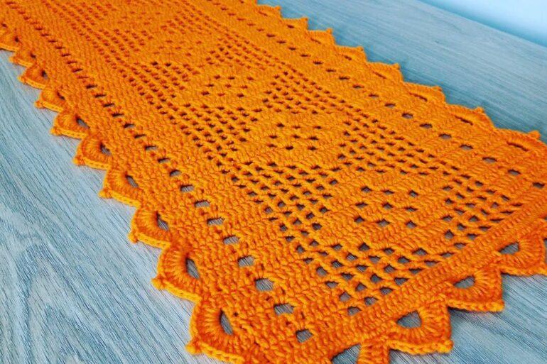 Passadeira de crochê laranja. Fonte: Ione Coutinho