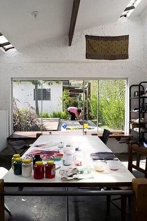 Porta de correr de vidro entre sala e quintal Projeto Odvo Arquitetura