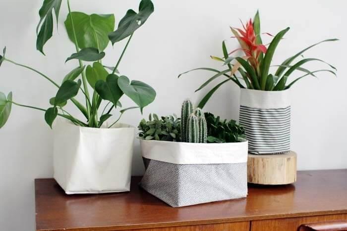Vasos de plantas com base de tecido