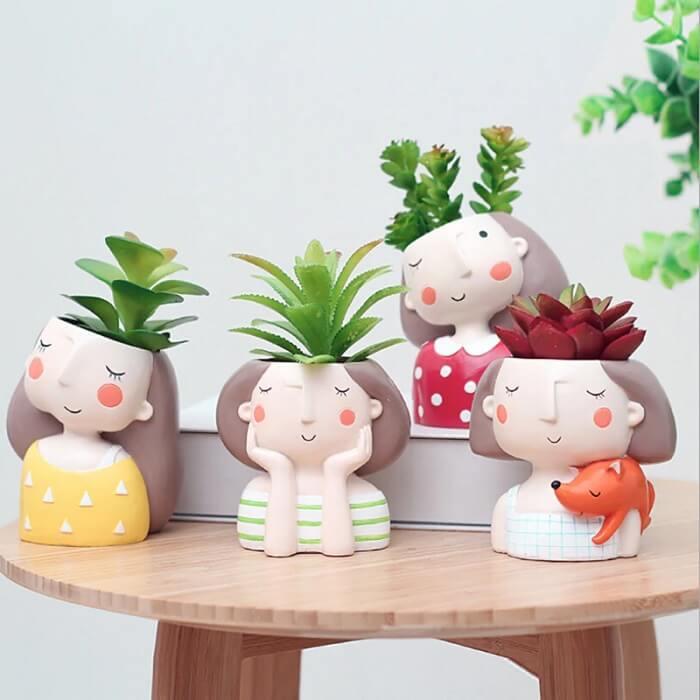 Vasos de plantas criativos feitos em resina