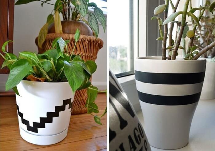 Vasos de plantas decorado com fitas de adesivo