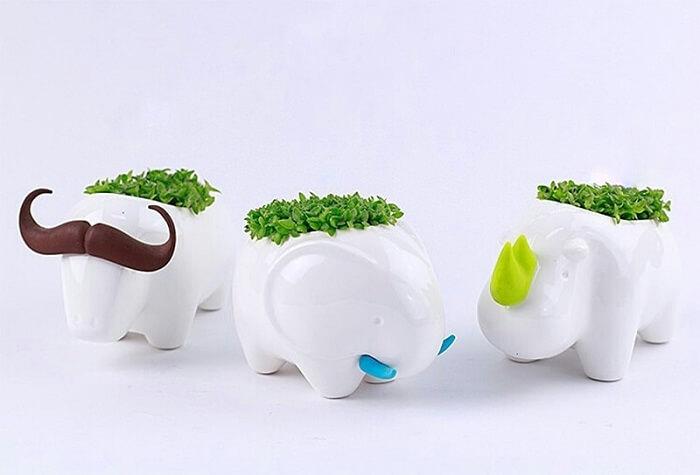 Vasos de plantas em porcelanato com formato de elefante