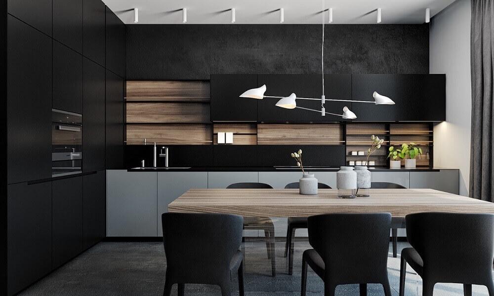 cozinha planejada preta bem iluminada