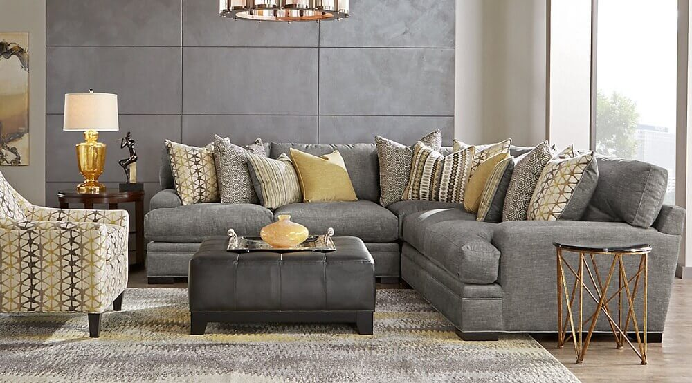 decoração sofisticada para sala com sofá cinza