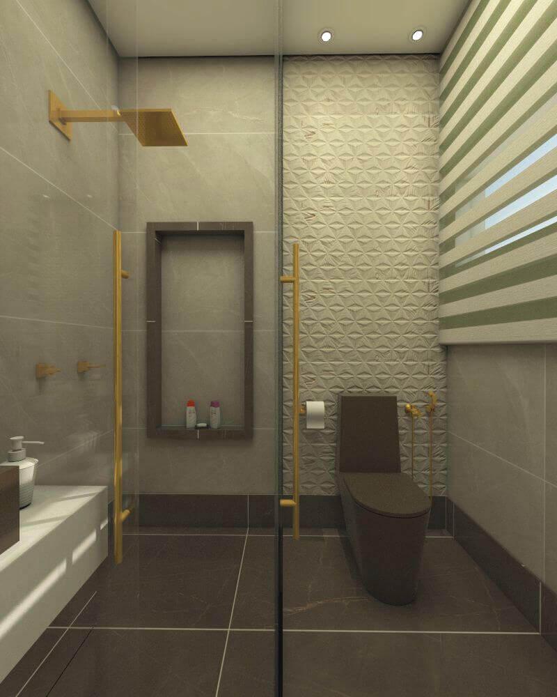 Banheiro decorado com chuveiro dourado