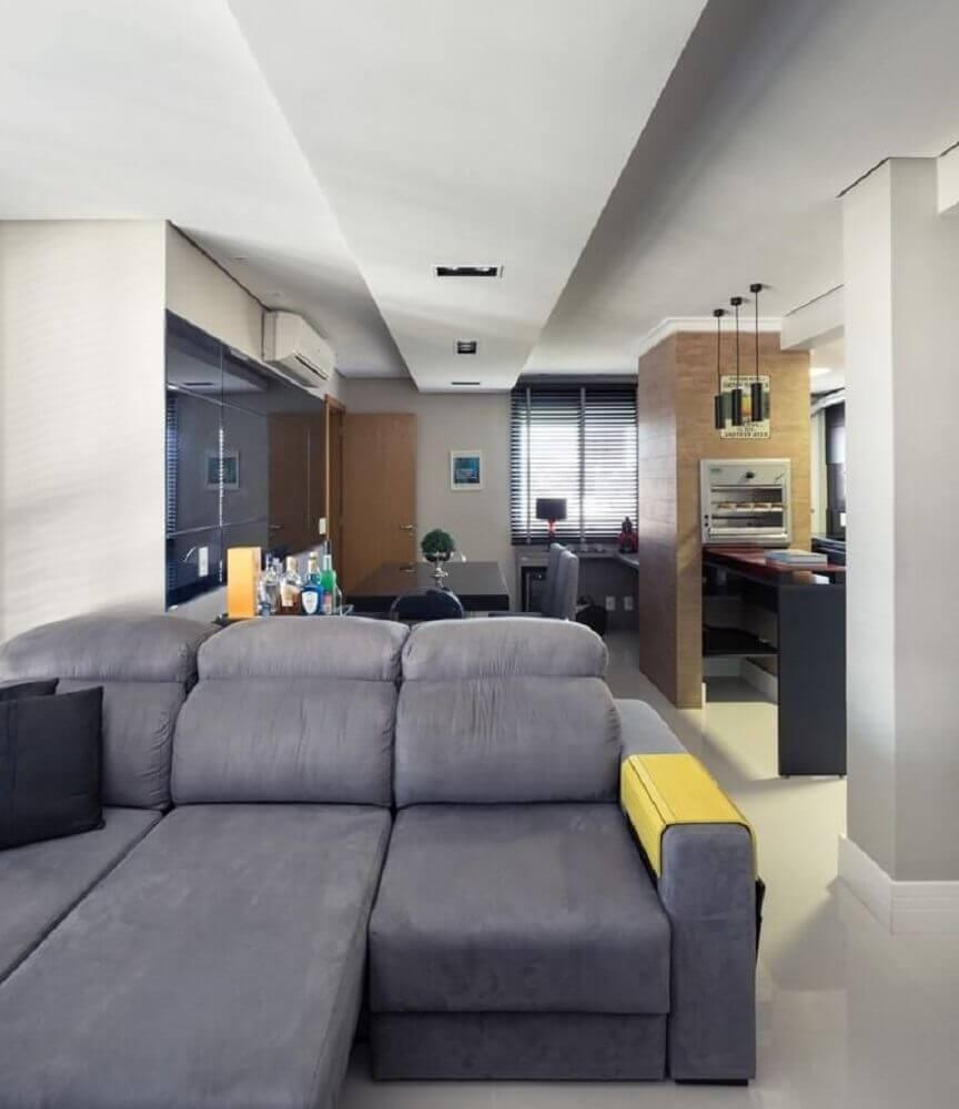 decoração sala de estar com sofá retrátil cinza