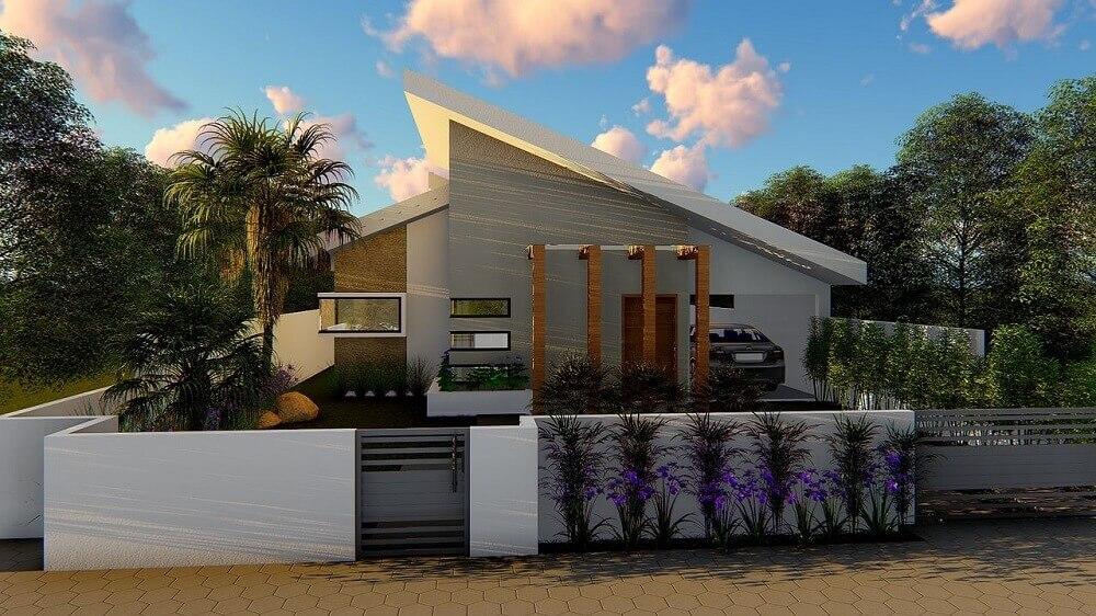 fachada de muro com jardim pequeno