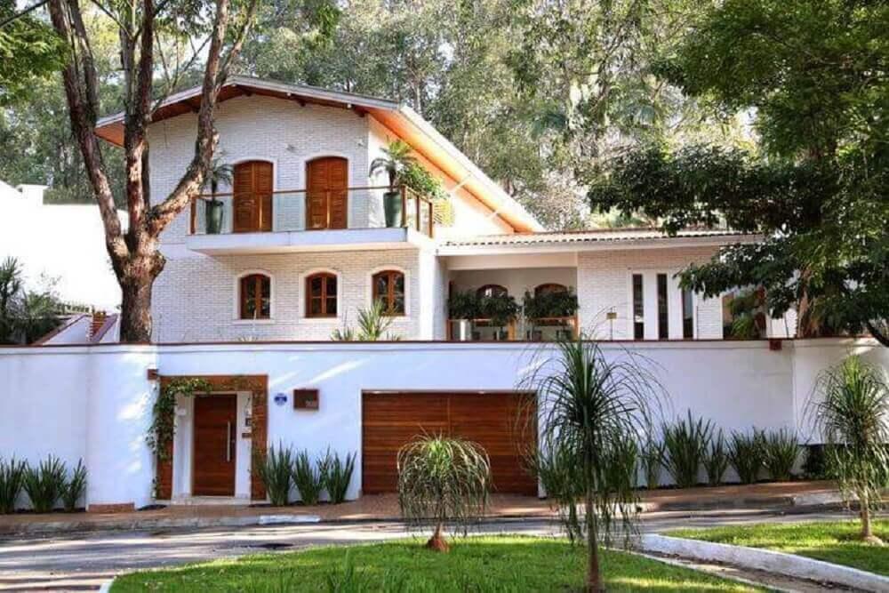 60 fachada de muro para inspirar o seu projeto for Casas modernas de 70m2