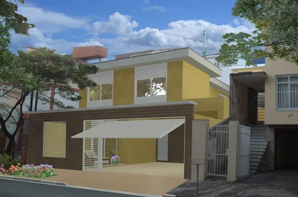 Frente de casas com muro marrom e portão branco