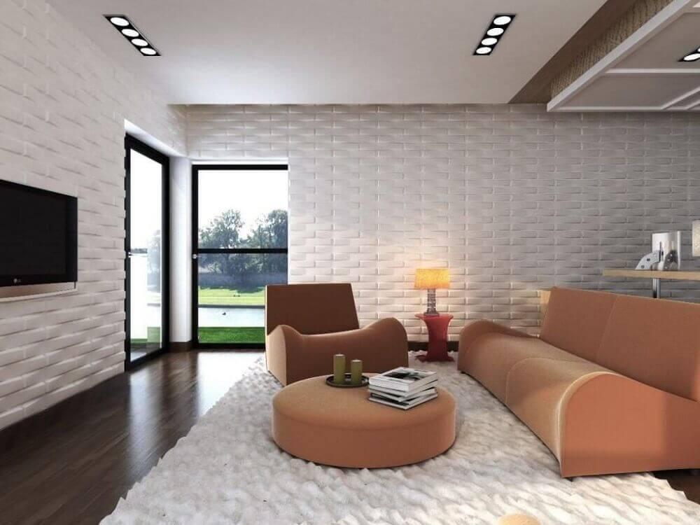 sala com parede decorada com gesso