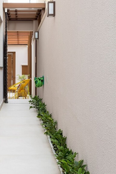 Arandelas externas no corredor Projeto de Juliana Conforto