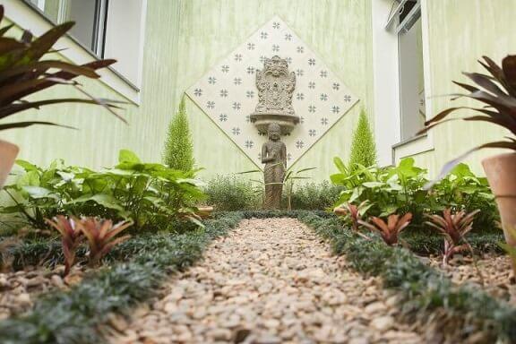 Como fazer um jardim de inverno com fonte Projeto de TT Interiores
