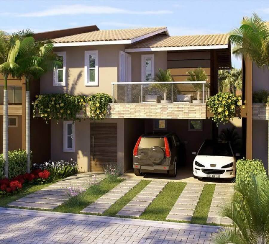 modelo de frente de casa com jardim e garagem