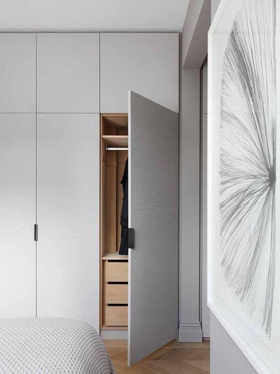 Armário embutido no quarto clean e moderno