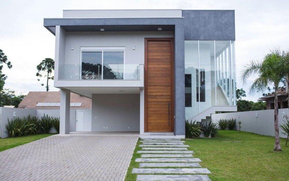casa com platibanda e cimento queimado