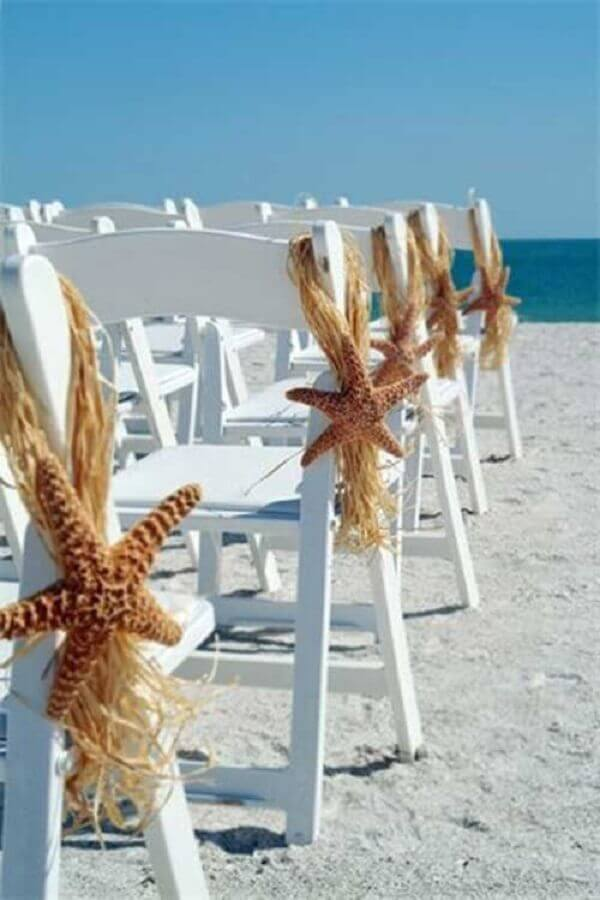 cerimônia de casamento na praia decorado com estrelas do mar Foto Pinterest