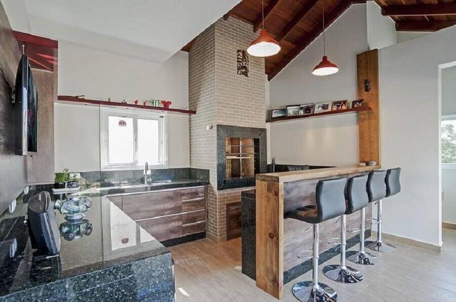 ambiente moderna com churrasqueira de alvenaria
