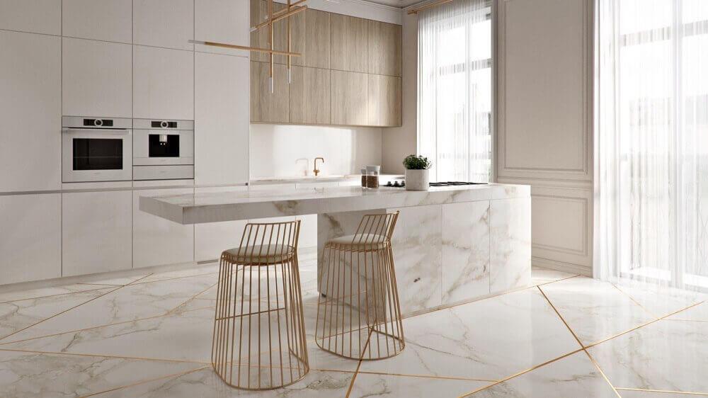 cozinha sofisticada decorada com luminária minimalista e banquetas para cozinha douradas Foto Pinterest