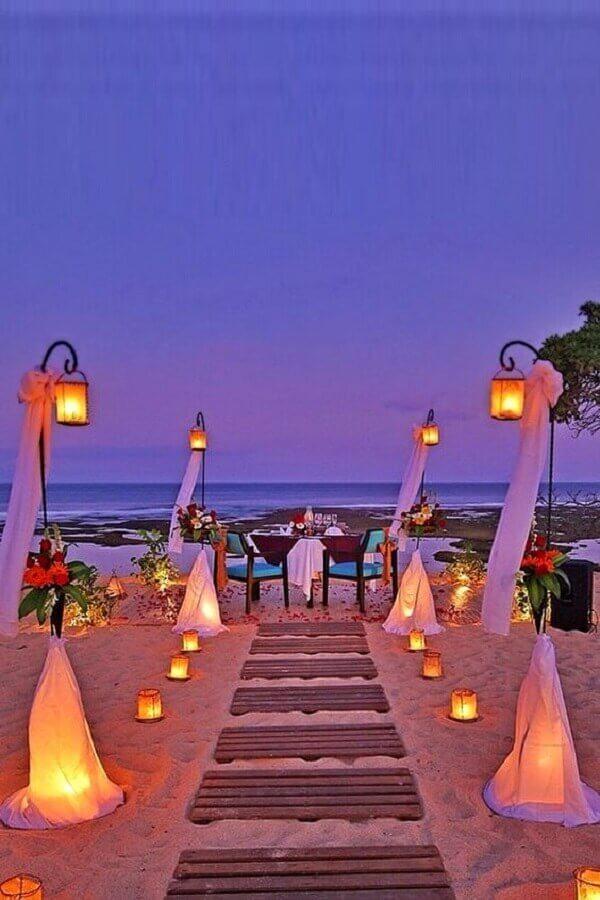 decoração casamento na praia noite com velas Foto Wedding Rings