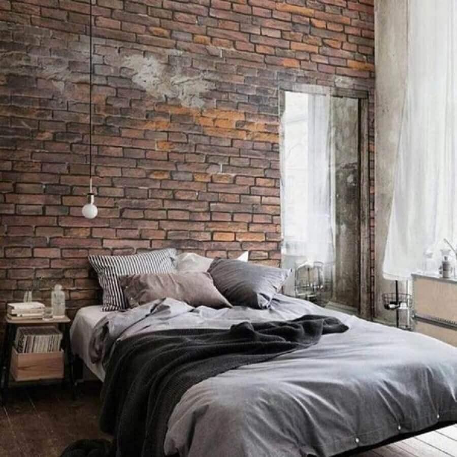 decoração de quarto masculino minimalista com parede de tijolinho