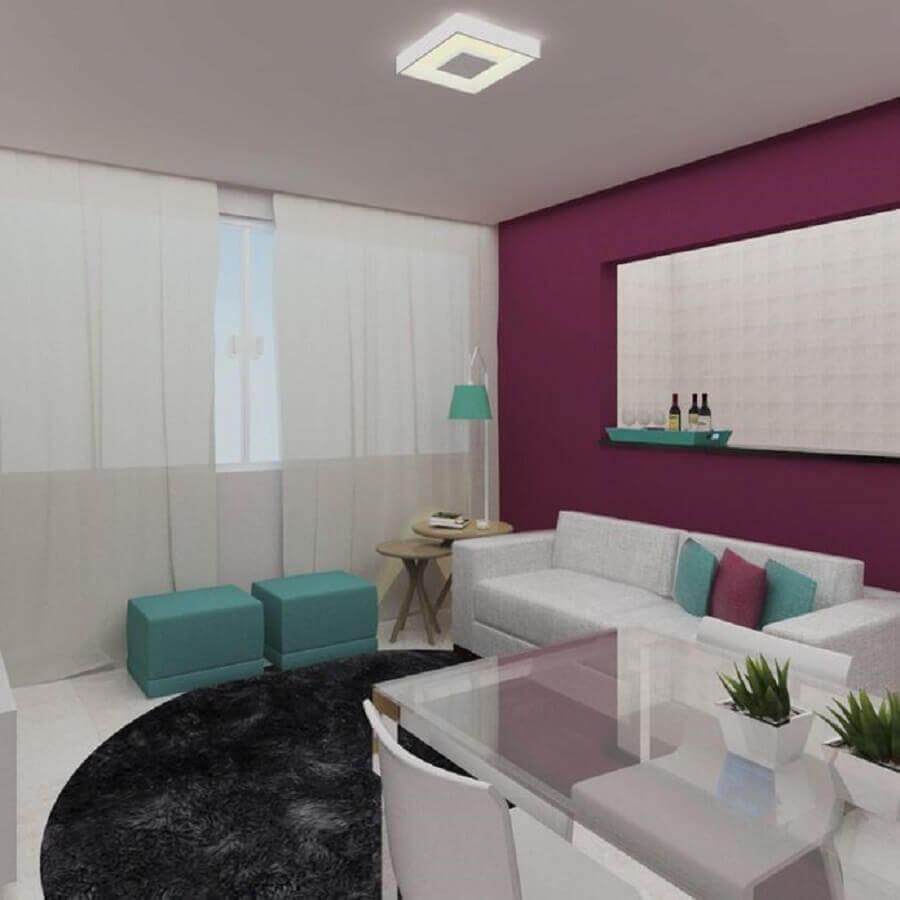 Decoração sala de estar pequena com puff verde água