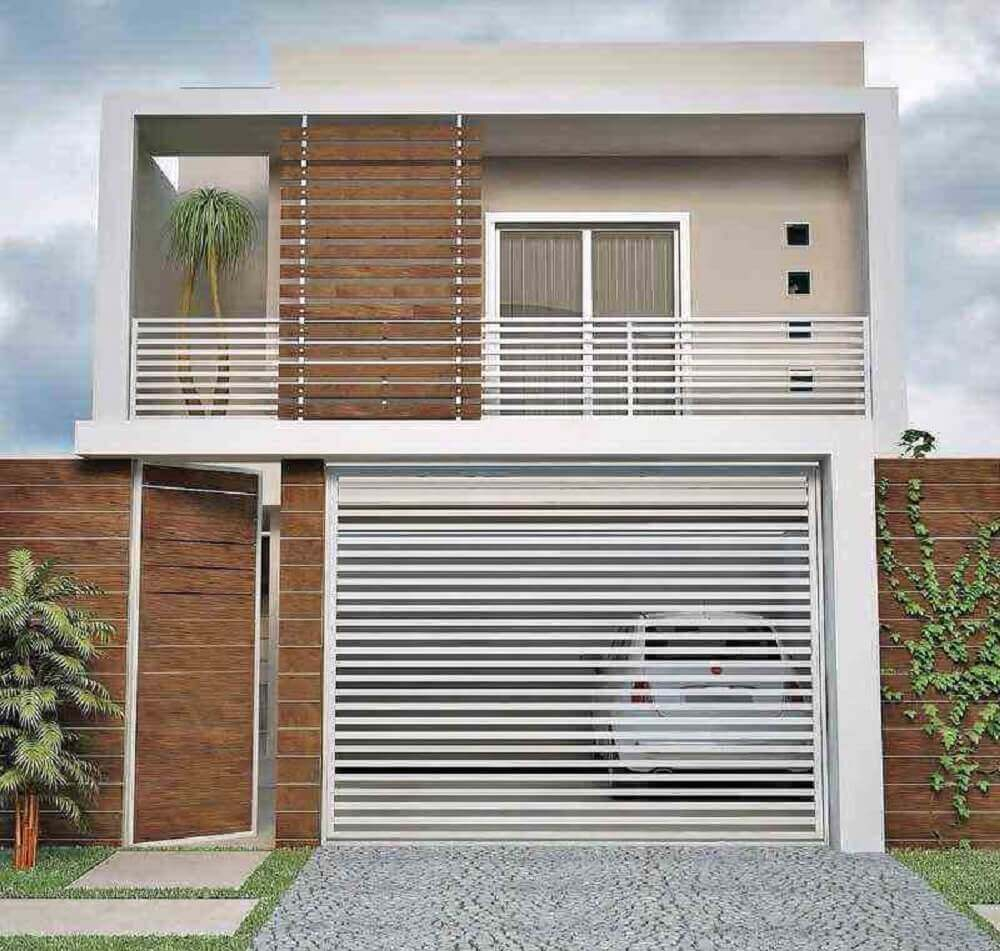 frente de casa com muro de madeira